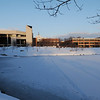 100216524e - Fairfax, VA, Center for the Arts and Mason Hall overlooking the Mason Pond in the snow on the Fairfax Campus. Photo by Evan Cantwell/Creative Services/George Mason University