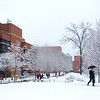 Students walk in the Fairfax Campus in the snow.  Photo by Creative Services/George Mason University