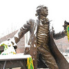 The Mason statue covered in snow and green and gold, Photo by Creative Services/George Mason University