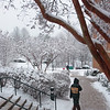 Students walk on Fairfax Campus in the snow. Photo by Creative Services/George Mason University