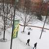 101217552e - Fairfax, VA, Students walking in the snow across campus. Photo by Evan Cantwell.