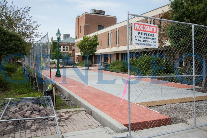 Campus infrastructure project in front of Erwin Hall new sidewalk concrete bricks being installed KW