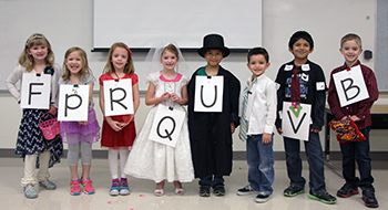 Students hold mock wedding to unite Letters Q and U