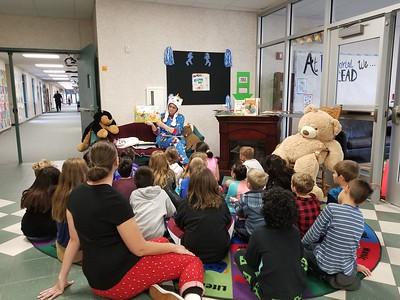 For National Young Readers Week, Ms. Haecker rises to the Principal's Challenge to read to the students of Memorial Elementary from the 1st Bell to the Last Bell.