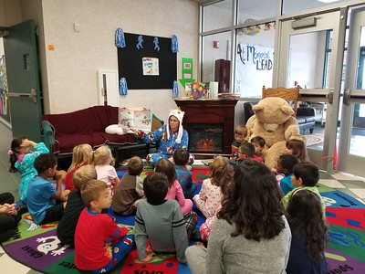 For National Young Readers Week Ms. Haecker rises to the Principal's Challenge to read to the students of Memorial Elementary from the 1st Bell to the Last Bell.