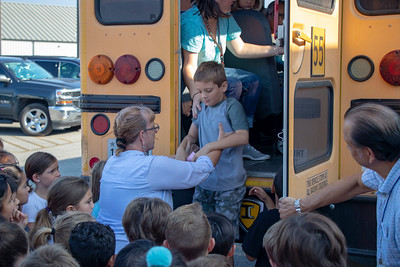 Bus drivers Ruth Castro and Albert Adame instruct students on the use of the rear emergency exit.