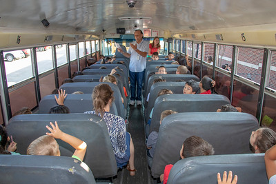 Bus drives Albert Adame discussing bus safety with students.