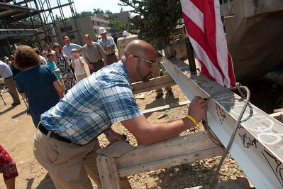 The topping off ceremony at U-Hall at Westfield State University. Workers and WSU employees sign the final I-beam to be raised into place at the new campus dormitory