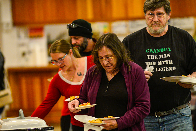 KRISTOPHER RADDER — BRATTLEBORO REFORMER<br /> Elaine Denyou gets a plate of food during the Can Cops Cook event at the VFW, in Brattleboro, on Saturday, Feb. 29, 2020.