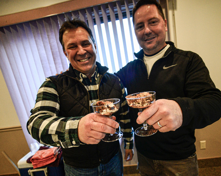 KRISTOPHER RADDER — BRATTLEBORO REFORMER<br /> Capt. Paul Samataro and Deputy Tim Vinton, of the Windham County Sheriff's Office, holds up a tiramisu that they made for the Can Cops Cook event at the VFW, in Brattleboro, on Saturday, Feb. 29, 2020.