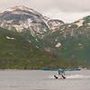 Alaska. Katmai NP. A DeHavilland Beaver lands at Kinak Bay, with Hidden Harbor in the background.