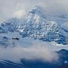 A bush plane heads north in the Alaska Range