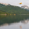 Alaska. Katmai NP. A DeHavilland Beaver takes off from Kinak Bay, with Hidden Harbor in the background.