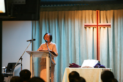 Pastor Chou speaks in Taiwanese service