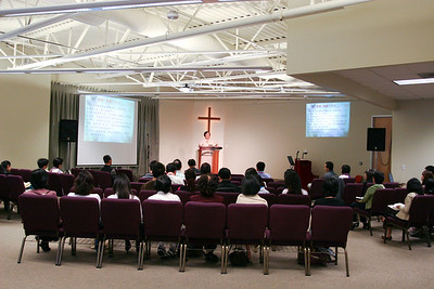 Pastor Chou speaks in Mandarin service
