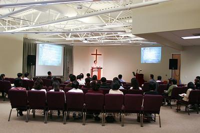 Pastor Chou speaks in Mandarin service