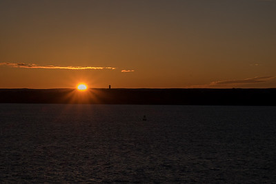 Sunrise sailing into Quebec City