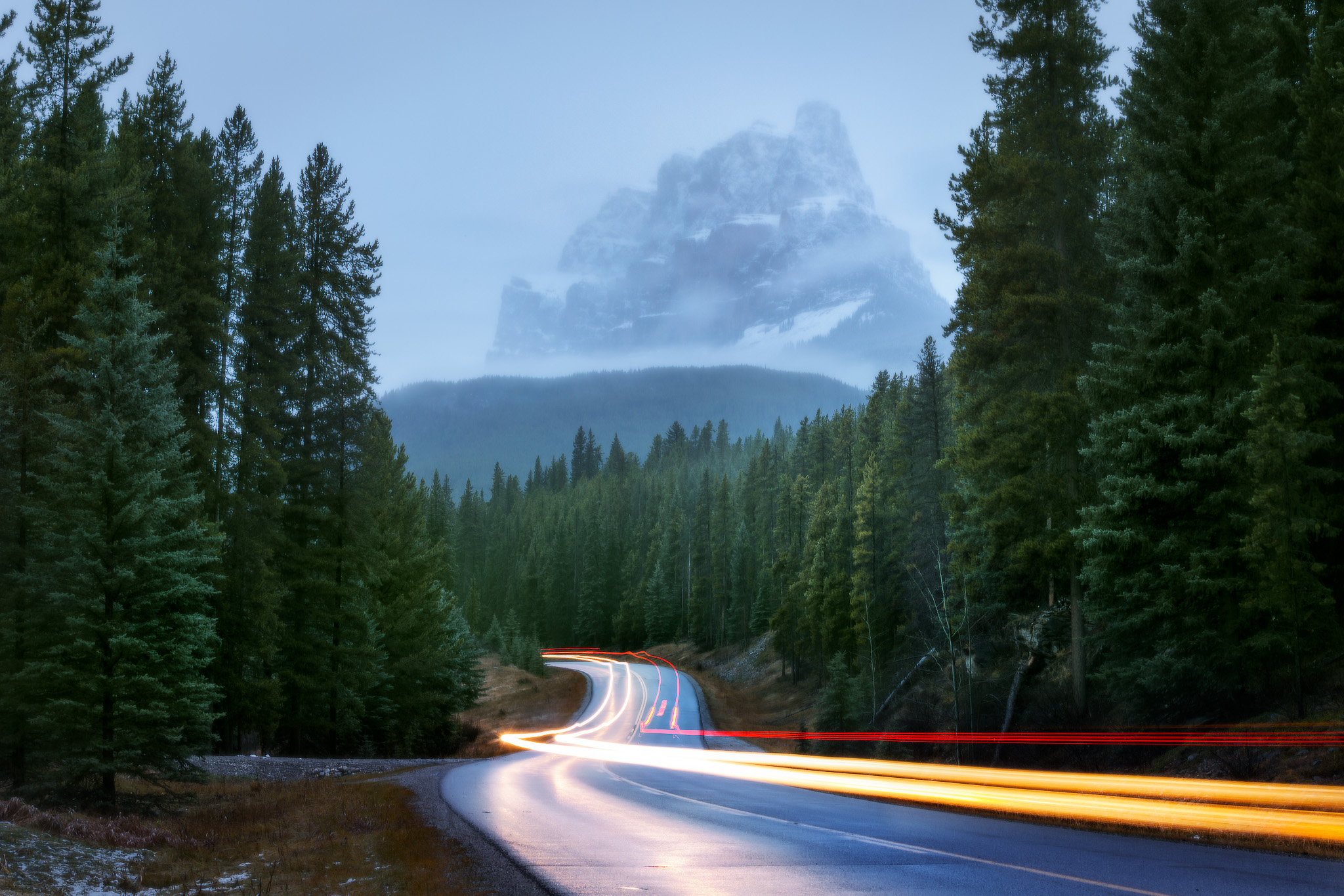 I drove up and down the Bow Valley Parkway which was deserted at this hour on a grey dawn