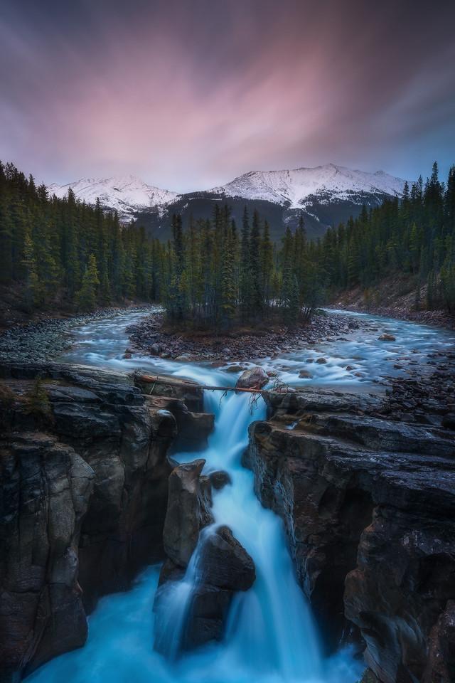 Sunwapta Falls on a gloomy eerie dusk with low flow.