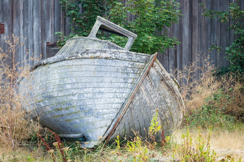 WA 009<br /> <br /> Fishing excursions are a thing of the past for this old boat that lies abandon outside a former salmon cannery.  Tongue Point Semiahmoo Spit, Washington.