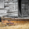 WA 005<br /> <br /> A retired fishing boat rests beside a weather boat shack on Lummi Island, Washington State.