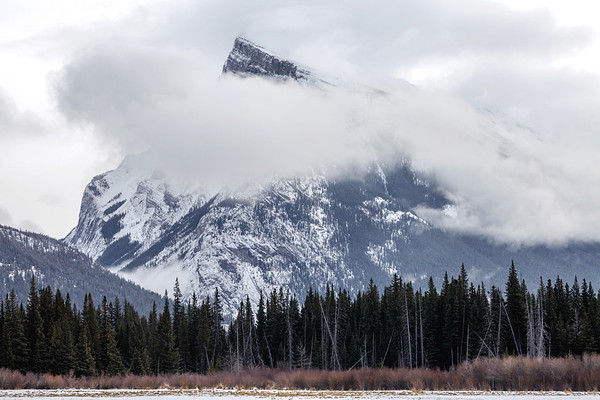 Mount Rundle on a cloudy day close to the town of Banff in Alberta