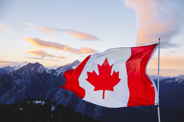 Canadian flag over the Rockies in Banff, Alberta.
