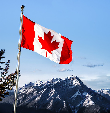 Canadian flag over the Rockies in Banff, Alberta