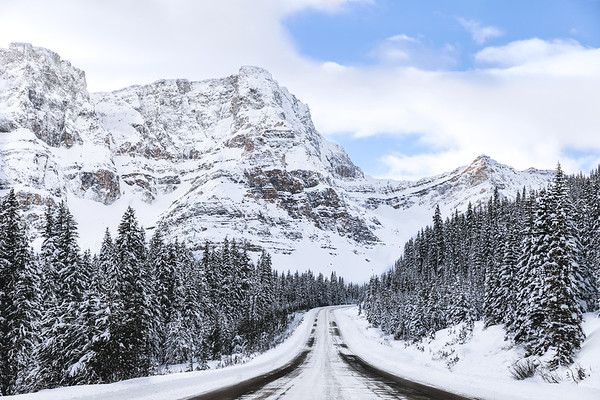 The Icefields Parkway is a beautiful scenic road surrounded by mountains and glaciers going through the Canadian Rockies.