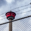 Calgary Tower behind a fence and barbwire