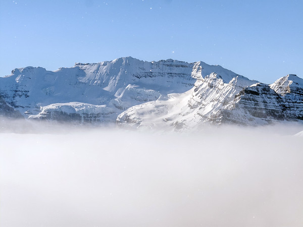 Light snow falling over the Canadian Rockies