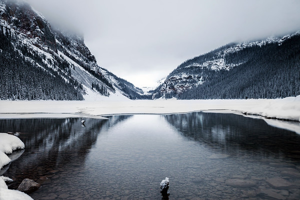 Lake Louise and surrounding mountains during winter time.