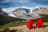Jasper, Icefields Centre - Two red Adirondack chairs overlooking the Athabasca Glacier