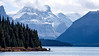 Jasper, Maligne Lake - Two people on end of point enjoying view of mountains