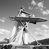Banff, Town - Man with ironing board and white cape from below, black and white