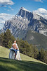 Banff, Town - Man in white cape ironing with Rundle in the background