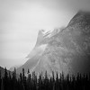 Banff, Vermillion - View of clouds on shoulder of rundle, bw