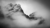 Banff, Moraine - Two summits shrouded in clouds and snow