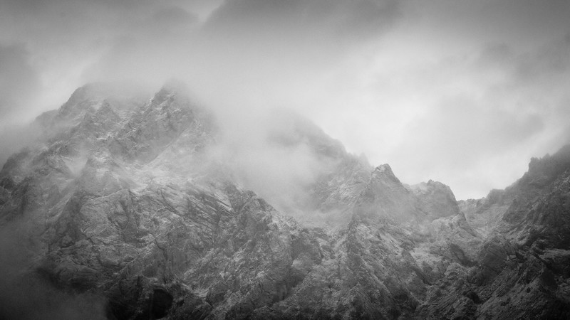 K Country, Near Lake - High mountains shrouded in clouds and snow, bw