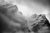 Banff, Moraine - Close up of two summits shrouded in clouds and snow