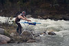 Banff, Icefields - Extreme ironing action next to whitewater rapids