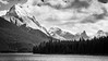 Jasper, Maligne Lake - Mountains and clouds over lake, black and white