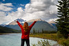 Banff, Icefields - Woman with hands up looking at river near Saskatchewan Bend