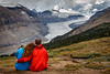 Banff, Icefields - Couple sitting and looking at Saskatchewan Glacier with her head on his shoulder