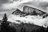 Banff, Town - View of Mt. Rundle with layers of clouds in black and white