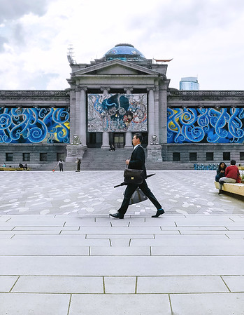 Man walking by the Vancouver Art Gallery.