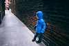 Vancouver Island, Victoria - Little boy in blue coat looking down Fan Tan Alley