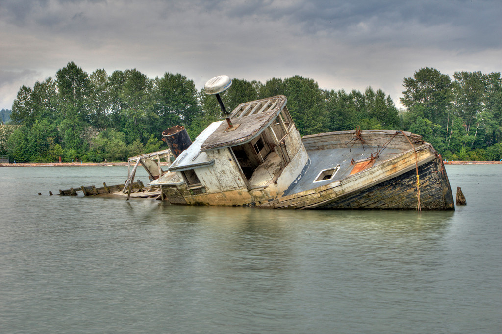 Fishing Boat relic on the Fraser River, Richmond BC. Shot taken at high tide