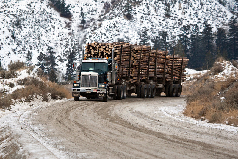 Logging Truck rounds one of the hairpins on the gravel road in Farwell Canyon, BC.