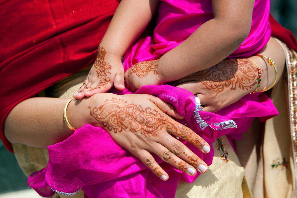 Mother and Daughter with Henna designs on their hands - Richmond Doors Open event